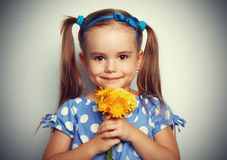 Beauty child girl with a bouquet of yellow flowers Royalty Free Stock Photography