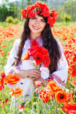 Beauty child girl in field of poppies Stock Images