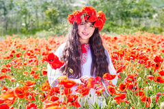 Beauty child girl in field of poppies Royalty Free Stock Image