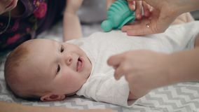 Beauty child holding toy. Close up of infant baby playing with mother stock footage