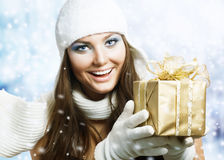 Beauty with Christmas Gift. Beautiful Happy Girl with Christmas Gift.Snowing stock photos