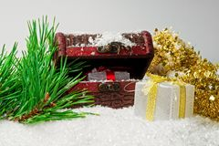 Beauty christmas gift boxes with ribbon, snow pine branches stock photo