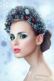 Beauty Christmas Girl. Beautiful Christmas wreath. New Year Stock Image