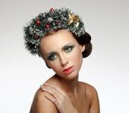 Beauty Christmas Girl. Beautiful Christmas wreath. Stock Photo