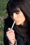 Beauty and cigarette. Sexy young lady smoke a cigarette Stock Photo