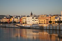 The colors of the popular district of Triana along the Guadalquivir river in Seville. The beauty of the city of Sevle, Spain, in the region of Andalusia royalty free stock photo