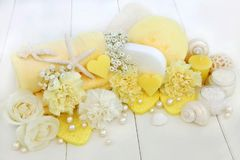 Beauty and Cleansing Spa Accessories. Beauty treatment cleansing and spa accessories including ex foliating salt, moisturising cream, heart shaped soaps, sponges Stock Photo