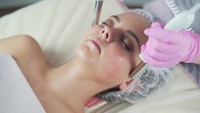 Beauty clinic. A woman gets beauty facial cosmetology procedure. stock footage