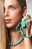 Beauty close up face head young woman necklace hand. Long hair side view Stock Photos