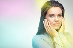 Beauty close up face portrait of young woman. Touching cheek. Isolated Royalty Free Stock Photos