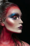 Beauty close-up portrait of beautiful woman model face with magic creative fashion multicolored make-up. Face painting, cosmetics, Royalty Free Stock Photography