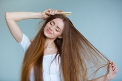 Beauty close-up portrait of beautiful young woman with long brown hair on white background. Hair care concept. Stock Images