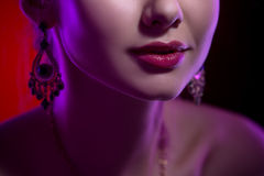 Beauty close-up portrait of female lips. Bright make-up. Model smiling Stock Images
