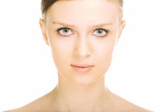 Beauty close-up portrait young woman face. On white background Stock Photography