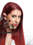 Beauty close-up woman with makeup brushes near her Stock Images