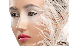 Beauty closeup girl with a white boa feather Royalty Free Stock Image