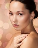Beauty Asian woman on caramel background Royalty Free Stock Photos