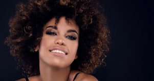 Beauty closeup portrait of girl with afro. Royalty Free Stock Photo