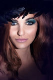 Beauty closeup portrait of redhead woman Stock Images