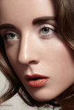 Beauty closeup of woman with fashion makeup, bright lips, strong eyebrows, clean face stock photo