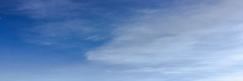 Beauty cloud against a blue sky background. Clouds sky. Blue sky with cloudy weather, nature cloud. White clouds, blue sky and sun. Beauty cloud against a blue royalty free stock image