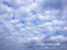 Beauty cloud against a blue sky background. Clouds sky. Blue sky with cloudy weather, nature cloud. White clouds, blue sky and sun. Beauty cloud against a blue stock photography