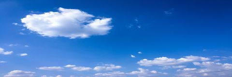 Beauty cloud against a blue sky background. Sky slouds. Blue sky with cloudy weather, nature cloud. White clouds, blue sky and sun. Beauty cloud against a blue royalty free stock photos