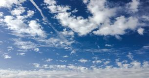 Beauty cloud against a blue sky background. Sky slouds. Blue sky with cloudy weather, nature cloud. White clouds, blue sky and sun. Beauty cloud against a blue royalty free stock images