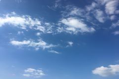 Beauty cloud against a blue sky background. Sky slouds. Blue sky with cloudy weather, nature cloud. White clouds, blue sky and sun. Beauty cloud against a blue stock photos
