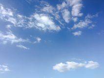Beauty cloud against a blue sky background. Sky slouds. Blue sky with cloudy weather, nature cloud. White clouds, blue sky and sun. Beauty cloud against a blue royalty free stock photography