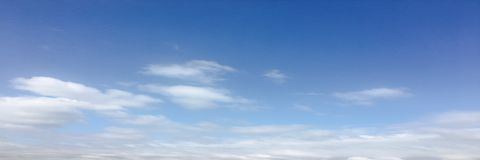 Beauty cloud against a blue sky background. Sky slouds. Blue sky with cloudy weather, nature cloud. White clouds, blue sky and sun. Beauty cloud against a blue stock image
