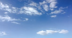 Beauty cloud against a blue sky background. Sky slouds. Blue sky with cloudy weather, nature cloud. White clouds, blue sky and sun. Beauty cloud against a blue royalty free stock image
