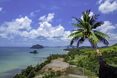 The beauty of coconut trees and the islands in the sea and sky at Sairee Sawee Beach , Chumphon Thailand.  stock image