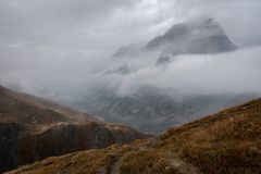 Mountain partly engulfed in clouds royalty free stock image
