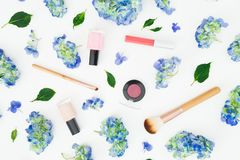 Beauty composition of hydrangea flowers and cosmetics on white background. Flat lay. Top view vector illustration