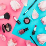 Beauty composition with tulips flowers and cosmetics on colorful background. Top view. Flat lay, home feminine desk. Beauty composition with tulips flowers and stock images