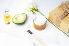 Beauty concept avocado skin care facial essence oil, soap, lily royalty free stock image
