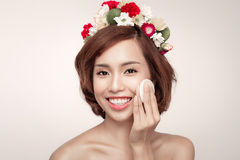 Beauty concept. Beautiful brunette lady removing makeup from her Stock Photo