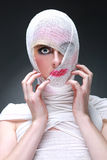 Beauty Concept of Heavy Makeup Seeping Through Gauze. Dramatic Beauty Concept of Heavy Makeup Seeping Through Gauze Royalty Free Stock Images