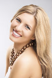 Beauty Concept: Portrait of Smiling Caucasian Blond Woman Over G Royalty Free Stock Photography