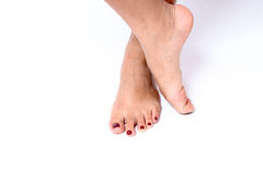 Beauty concept of red painted toenails Stock Images