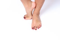Beauty concept of red painted toenails Royalty Free Stock Photography