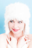 Beauty concept with smiling female model with fur hat Stock Images