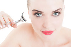 Beauty concept with woman using eyelash curler Royalty Free Stock Image