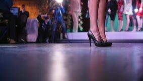 Beauty contest. Woman on high heels walking