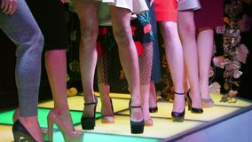 Beauty contest. Woman models standing on high heels next to each other.