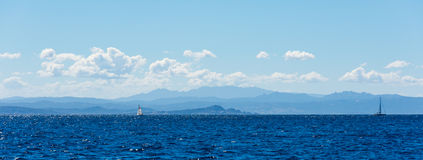 Beauty of Corsica nature. Landscape of Corsica nature, sea and mountains. Travels with boat to near city stock photography