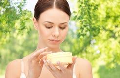 Beautiful woman with moisturizing cream royalty free stock photo