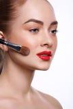 Beauty, cosmetics, finish make-up, powder brush stock image