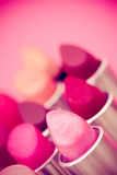 Beauty & cosmetics:lipsticks and lipgloss. Cosmetics: lipsticks shot at shallow depth of field Royalty Free Stock Photos